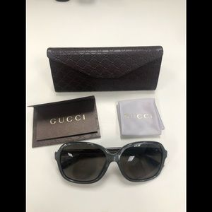 Authentic Gucci sunglasses **Never worn**